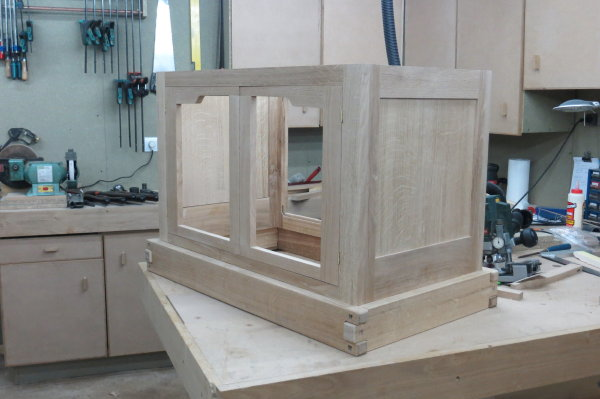Plinth was assembled with dowels punched down below the surface to ...